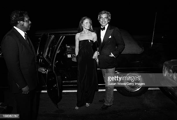 As their chauffeur holds the door open American fashion designer Ralph Lauren and his wife therapist Ricky Lauren smile as they get out of a limosine...