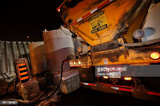 As Toronto falls into a deepfreeze city crews fill tanks on the salt trucks with Fusion Liquid Deicer which is an organic solution containing beet...