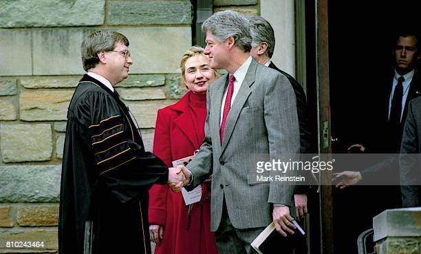 As US First Lady Hillary Clinton watches President Bill Clinton shakes hands with the pastor at the First Baptist Church of the City of Washington DC...