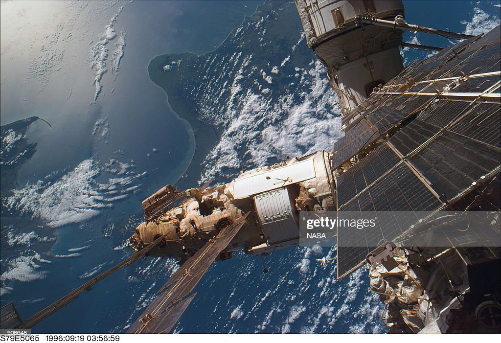 As viewed from Atlantis'' flight deck backdropped against Cook Strait the Tasman Sea and the South Pacific several components of Mir greet STS79...