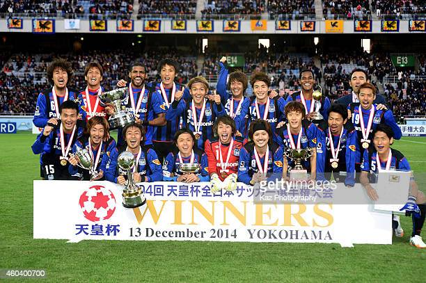 As winners of Emperor's Cup Gamba Osaka players pose for a photo with their cups during the Emperor's Cup final match between Gamba Osaka and...