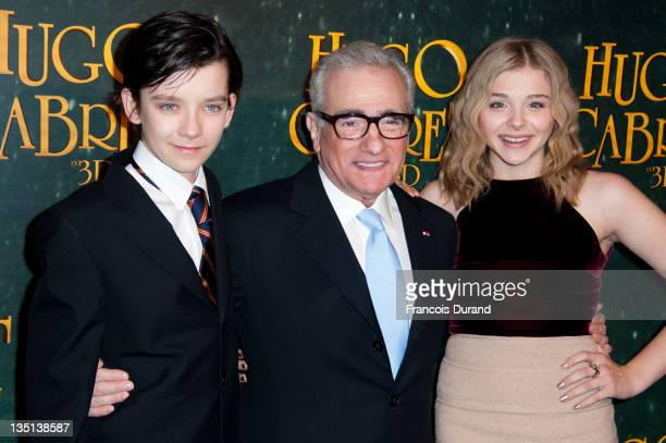 Asa Butterfield Martin Scorsese and Chloe Moretz attend 'Hugo Cabret 3D' premiere at Cinema UGC Normandie on December 6 2011 in Paris France