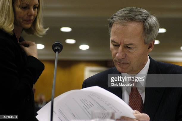Asa Hutchinson undersecretary for border and transportation security Homeland Security Department with an aide before testifying at a Homeland...