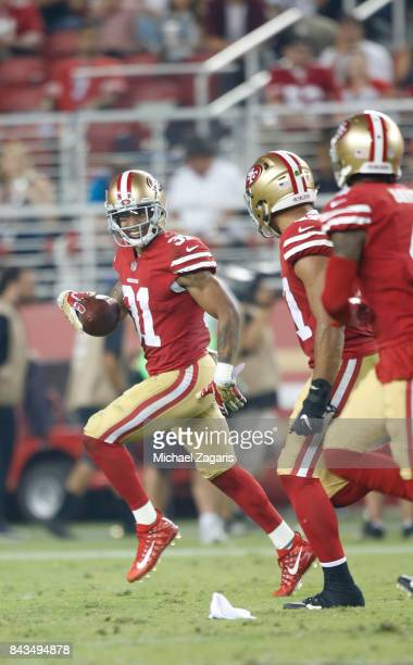 Asa Jackson of the San Francisco 49ers returns an interception during the  game against the Los ... 301779421