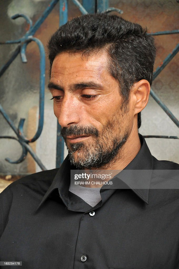 Asaad Asaad, a Lebanese survivor of the migrant shipwreck in Indonesia last week, looks on after his arrival at the family's home on October 6, 2013 in Akkar, an impoverished and remote province of north Lebanon. The 18 survivors, who returned to Lebanon, expressed their anger against the Lebanese state that they accuse of disregarding their difficulties with the influx of Syrian refugees. Assaad lost his wife and their 3 children. AFP PHOTO IBRAHIM CHALHOUB