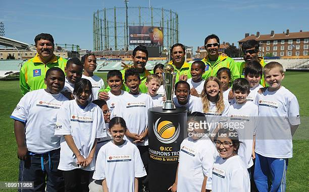 Asad Shafiq Abdur Rehman Nasir Jamshed with other members of the Pakistan Team pose for a photograph with children from the Curwen Primary School and...