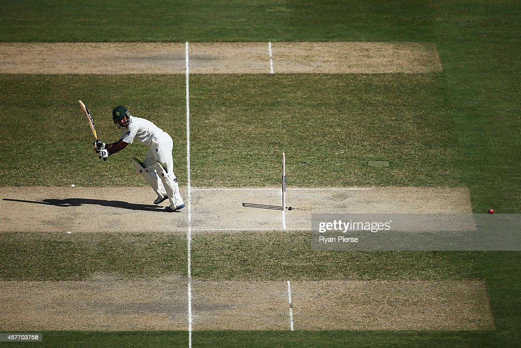 <a gi-track='captionPersonalityLinkClicked' href=/galleries/search?phrase=Asad+Shafiq&family=editorial&specificpeople=7061328 ng-click='$event.stopPropagation()'>Asad Shafiq</a> of Pakistan bats during Day Two of the First Test between Pakistan and Australia at Dubai International Stadium on October 23, 2014 in Dubai, United Arab Emirates.