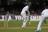 Asad Shafiq of Pakistan edges the ball through the slips for four runs during day 3 of the First Investec Test match between England and Pakistan at...