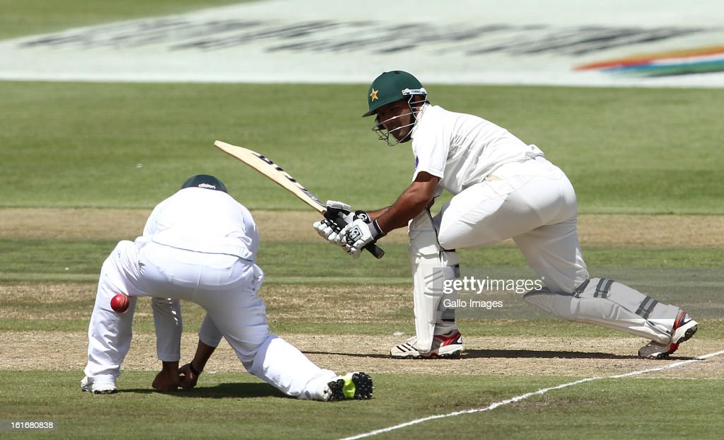<a gi-track='captionPersonalityLinkClicked' href=/galleries/search?phrase=Asad+Shafiq&family=editorial&specificpeople=7061328 ng-click='$event.stopPropagation()'>Asad Shafiq</a> of Pakistan plays the ball through the legs of Dean Elgar of South Africa during Day One of the 2nd Test match between South Africa and Pakistan at Sahara Park Newlands on February 14, 2013 in Cape Town, South Africa.