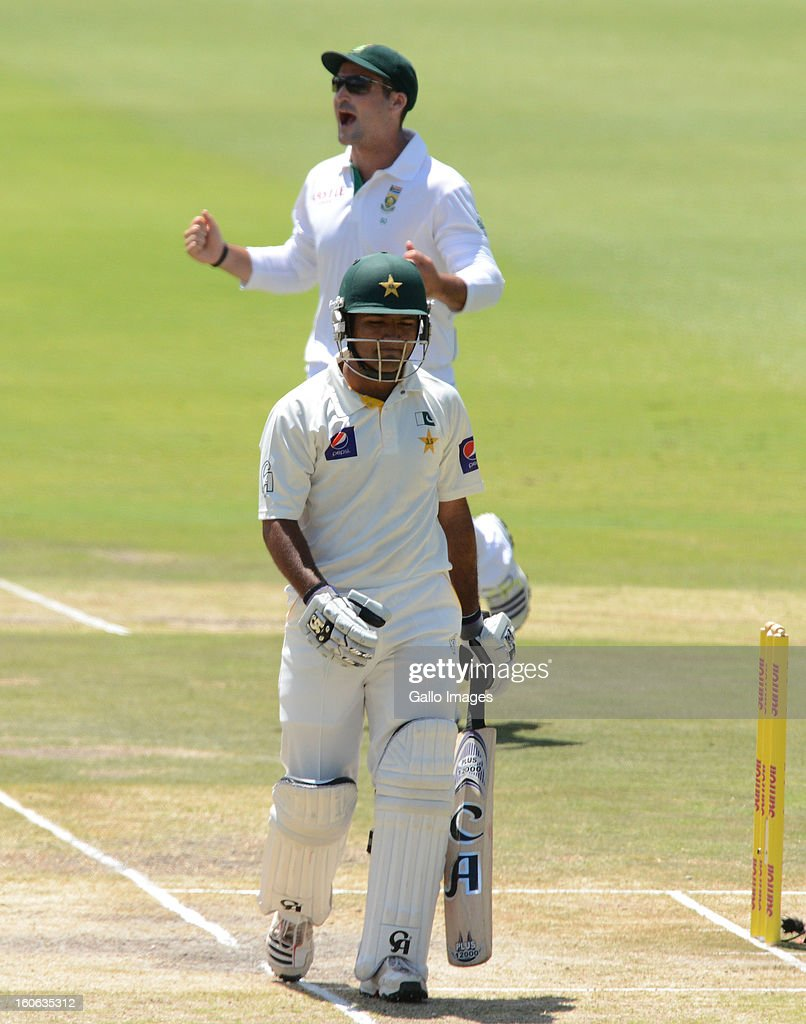 <a gi-track='captionPersonalityLinkClicked' href=/galleries/search?phrase=Asad+Shafiq&family=editorial&specificpeople=7061328 ng-click='$event.stopPropagation()'>Asad Shafiq</a> of Pakistan walks off for 56 runs during day 4 of the 1st Test match between South Africa and Pakistan at Bidvest Wanderers Stadium on February 4, 2013 in Johannesburg, South Africa.
