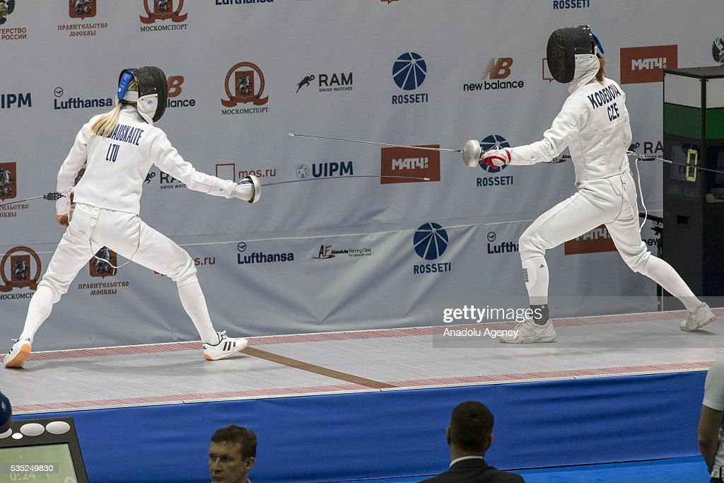 Asadauskaite Laura (L) from Lithuania and Kodedova Barbora from Czech Republic compete in the fencing at the mixed relay World Championship in modern pentathlon in Olympic Sports Complex in Moscow, Russia, on May 29, 2016.