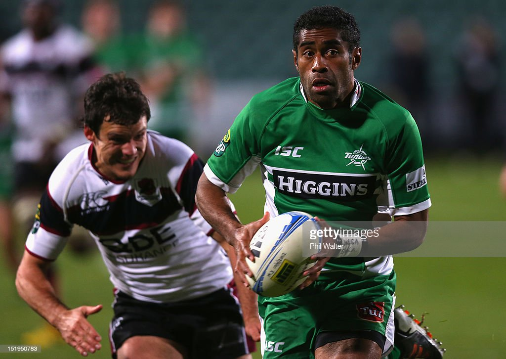 Asaeli Tikoirotuma of Manawatu offloads the ball during the round seven ITM Cup match between North Harbour and Manawatu at North Harbour Stadium on September 13, 2012 in Auckland, New Zealand.