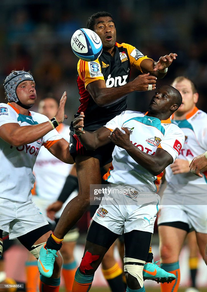 Asaeli Tikoirotuma of the Chiefs gets over the high ball on top of Raymond Rhule of the Cheetahs during the round three Super Rugby match between the Chiefs and the Cheetahs at Waikato Stadium on March 2, 2013 in Hamilton, New Zealand.