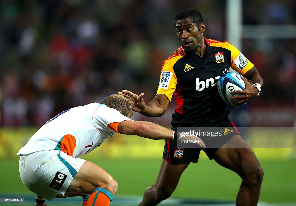Asaeli Tikoirotuma of the Chiefs is tackled by Sarel Pretorius of the Cheetahs during the round three Super Rugby match between the Chiefs and the Cheetahs at Waikato Stadium on March 2, 2013 in Hamilton, New Zealand.