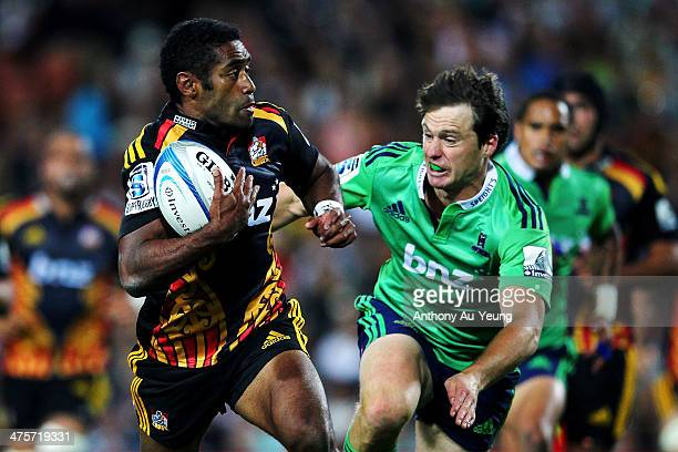 Asaeli Tikoirotuma of the Chiefs makes a run against Ben Smith of the Highlanders during the round three Super Rugby match between the Chiefs and the...