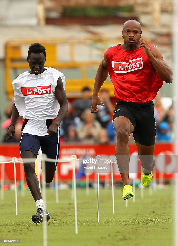 <a gi-track='captionPersonalityLinkClicked' href=/galleries/search?phrase=Asafa+Powell&family=editorial&specificpeople=240116 ng-click='$event.stopPropagation()'>Asafa Powell</a> of Jamaica competes in the Australia Post Stawell Gift Heat 11 during the 2013 Stawell Gift carnival at Central Park on March 30, 2013 in Stawell, Australia.