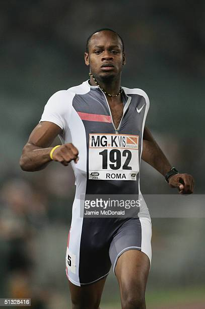 Asafa Powell of Jamaica competes in the Men's 200 metres race during the IAAF Golden Gala at the Stadio Olimpico on July 2 2004 in Rome Italy