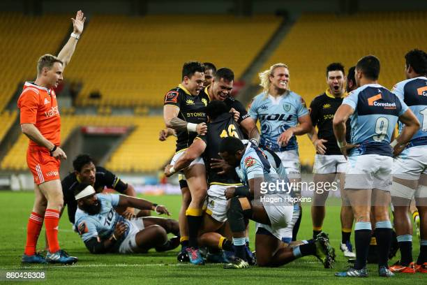 Asafo Aumua of Wellington celebrates with Carlos Price and Alex Fidow after scoring a try during the round nine Mitre 10 Cup match between Wellington...