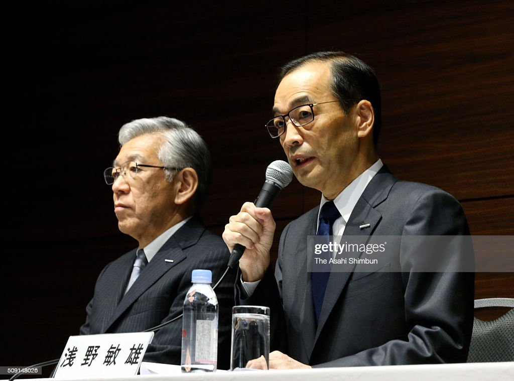 Asahi Kasei outgoing president Toshio Asano (R) talks while incoming president Hideki Kobori (L) listens during a press conference on February 9, 2016 in Tokyo, Japan. Asano steps down to take responsibility for the falsified piling data scandal by its subsidiary Asahi Kasei Construction Materials.