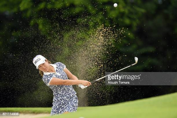 Asako Fujimoto of Japan hits from a bunker on the 4th hole during the final round of the Century 21 Ladies Golf Tournament 2017 at the Seta Golf...