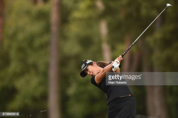 Asako Fujimoto of Japan hits her second shot on the 5th hole during the final round of the World Ladies Championship Salonpas Cup at the Ibaraki Golf...