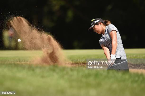 Asako Fujimoto of Japan hits out of the 11th green bunker during the second round of the Nichirei Ladies at the on June 17 2017 in Chiba Japan