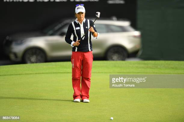 Asako Fujimoto of Japan lines up her putt on the 18th hole during the second round of the Nobuta Group Masters GC Ladies at the Masters Golf Club on...