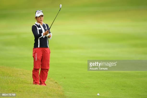 Asako Fujimoto of Japan lines up her second shot on the 18th hole during the second round of the Nobuta Group Masters GC Ladies at the Masters Golf...