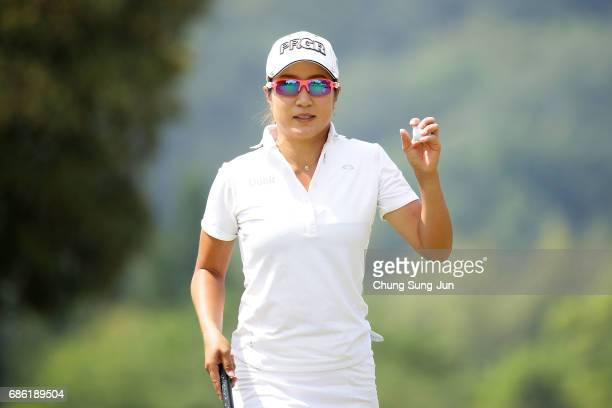 Asako Fujimoto of Japan reacts after a putt on the 18th green during the final round of the Chukyo Television Bridgestone Ladies Open at the Chukyo...