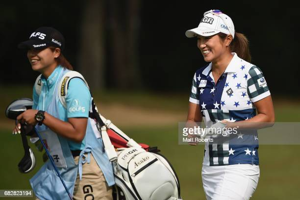 Asako Fujimoto of Japan smiles as she walks the 1st fairway during the final round of the HokennoMadoguchi Ladies at the Fukuoka Country Club Wajiro...