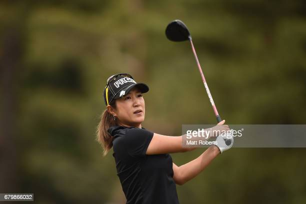 Asako Fujimoto of Japan watches her tee shot on the 7th hole during the final round of the World Ladies Championship Salonpas Cup at the Ibaraki Golf...