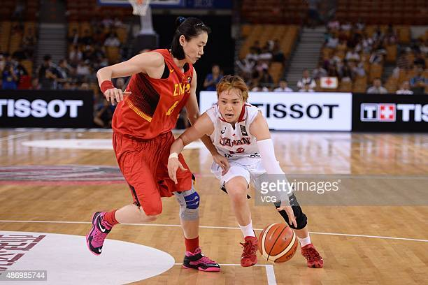 Asami Yoshida of Japan competes for the ball in finals match between Japan and China during the 2015 FIBA Asia Championship for Women at Wuhan Sports...