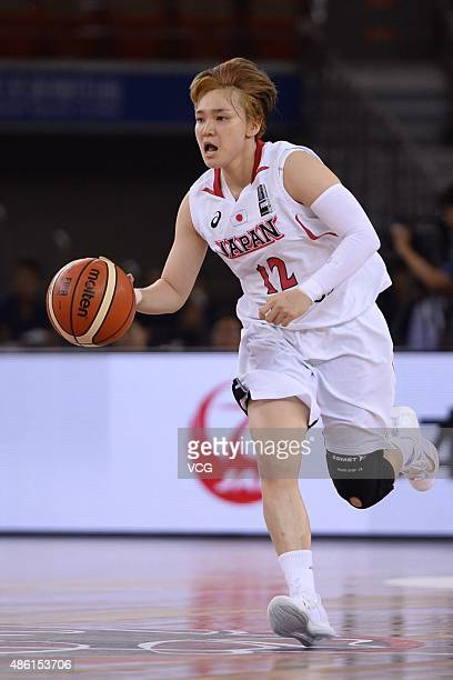 Asami Yoshida of Japan handles the ball during a group match between China and Japan as part of the 2015 FIBA Asia Championship for Women at Wuhan...