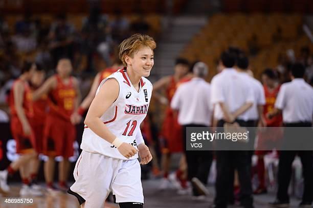 Asami Yoshida of Japan runs in finals match between Japan and China during the 2015 FIBA Asia Championship for Women at Wuhan Sports Center Gymnasium...