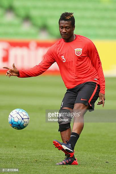 Asamoah Gyan kicks the ball during the Shanghai SIPG training session at AAMI Park on February 23 2016 in Melbourne Australia