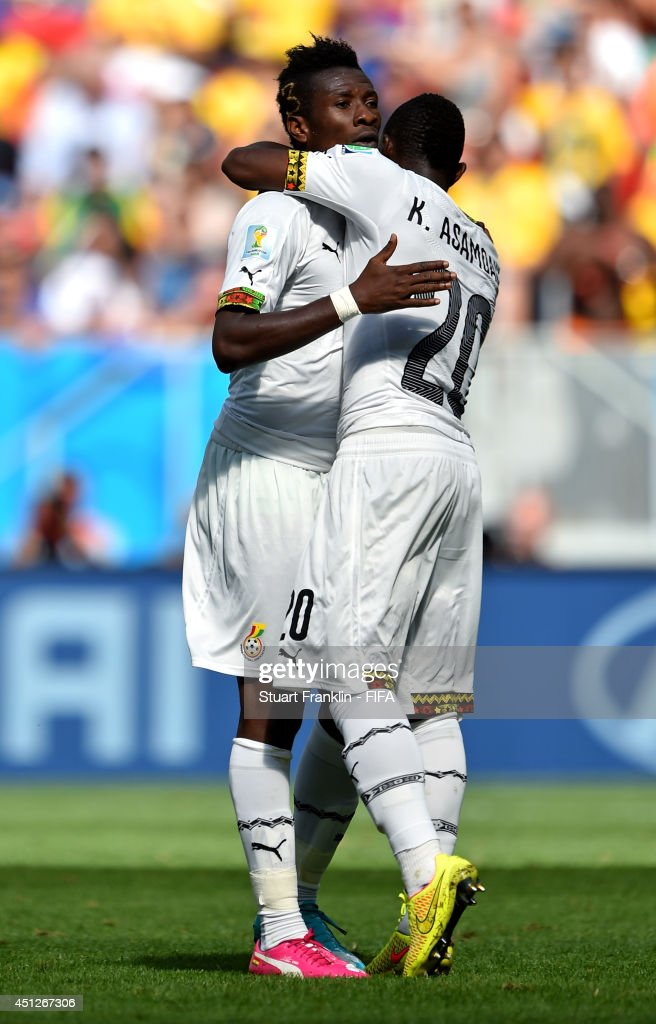 <a gi-track='captionPersonalityLinkClicked' href=/galleries/search?phrase=Asamoah+Gyan&family=editorial&specificpeople=535782 ng-click='$event.stopPropagation()'>Asamoah Gyan</a> (C) of Ghana celebrates scoring his team's firs goal with his teammate <a gi-track='captionPersonalityLinkClicked' href=/galleries/search?phrase=Kwadwo+Asamoah&family=editorial&specificpeople=4376914 ng-click='$event.stopPropagation()'>Kwadwo Asamoah</a> (R) during the 2014 FIFA World Cup Brazil Group G match between Portugal and Ghana at Estadio Nacional on June 26, 2014 in Brasilia, Brazil.