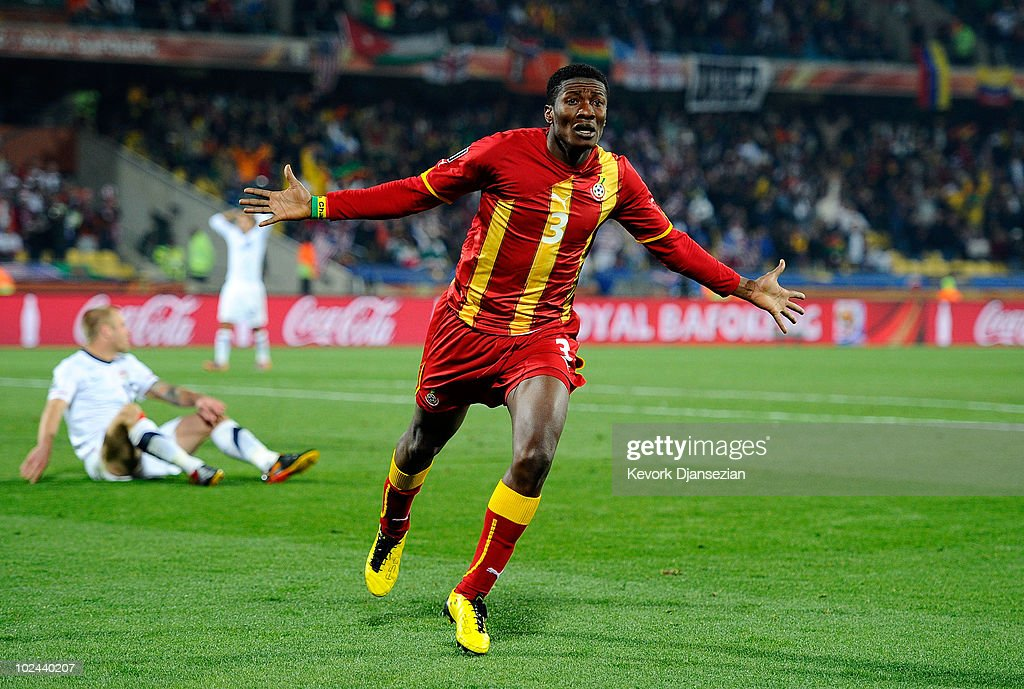 <a gi-track='captionPersonalityLinkClicked' href=/galleries/search?phrase=Asamoah+Gyan&family=editorial&specificpeople=535782 ng-click='$event.stopPropagation()'>Asamoah Gyan</a> of Ghana celebrates scoring his team's second goal in extra time during the 2010 FIFA World Cup South Africa Round of Sixteen match between USA and Ghana at Royal Bafokeng Stadium on June 26, 2010 in Rustenburg, South Africa.