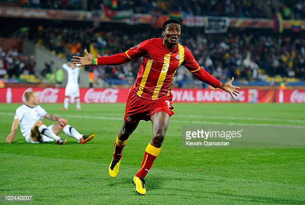 Asamoah Gyan of Ghana celebrates scoring his team's second goal in extra time during the 2010 FIFA World Cup South Africa Round of Sixteen match...
