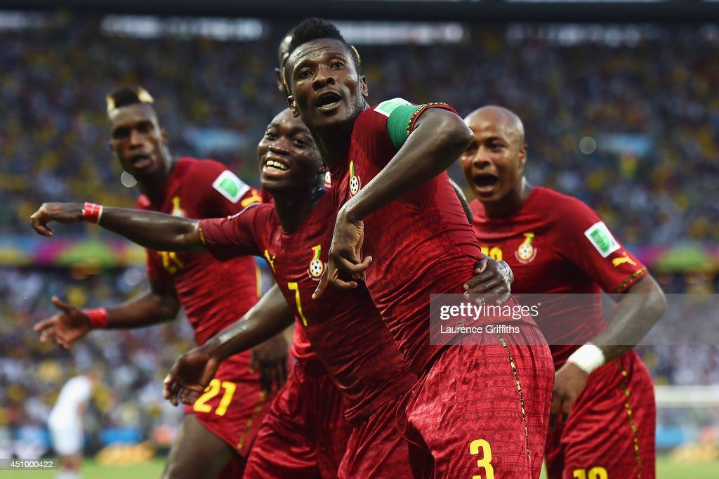 Asamoah Gyan of Ghana celebrates scoring his team's second goal with teammates during the 2014 FIFA World Cup Brazil Group G match between Germany and Ghana at Castelao on June 21, 2014 in Fortaleza, Brazil.
