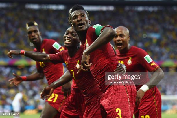 Asamoah Gyan of Ghana celebrates scoring his team's second goal with teammates during the 2014 FIFA World Cup Brazil Group G match between Germany...