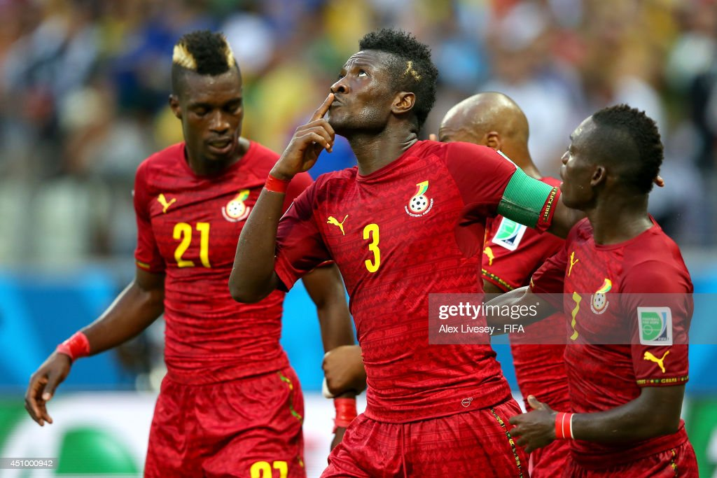 Asamoah Gyan (C) of Ghana celebrates scoring his team's second goal with his teammates Christian Atsu (R) and John Boye (L) during the 2014 FIFA World Cup Brazil Group G match between Germany and Ghana at Castelao on June 21, 2014 in Fortaleza, Brazil.