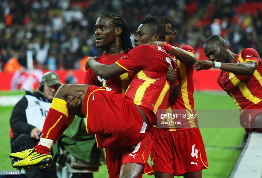 <a gi-track='captionPersonalityLinkClicked' href=/galleries/search?phrase=Asamoah+Gyan&family=editorial&specificpeople=535782 ng-click='$event.stopPropagation()'>Asamoah Gyan</a> of Ghana celebrates with Derek Bopateng after he scores the equalising goal during the international friendly match between England and Ghana at Wembley Stadium on March 29, 2011 in London, England.
