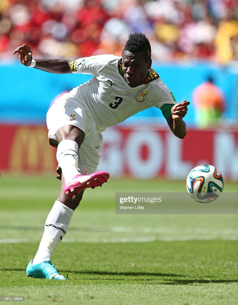 Asamoah Gyan of Ghana controls the ball during the 2014 FIFA World Cup Brazil Group G match between Portugal and Ghana at Estadio Nacional on June 26...