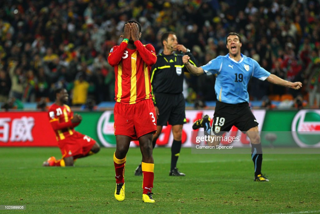 <a gi-track='captionPersonalityLinkClicked' href=/galleries/search?phrase=Asamoah+Gyan&family=editorial&specificpeople=535782 ng-click='$event.stopPropagation()'>Asamoah Gyan</a> of Ghana reacts as he misses a late penalty kick in extra time to win the match during the 2010 FIFA World Cup South Africa Quarter Final match between Uruguay and Ghana at the Soccer City stadium on July 2, 2010 in Johannesburg, South Africa.