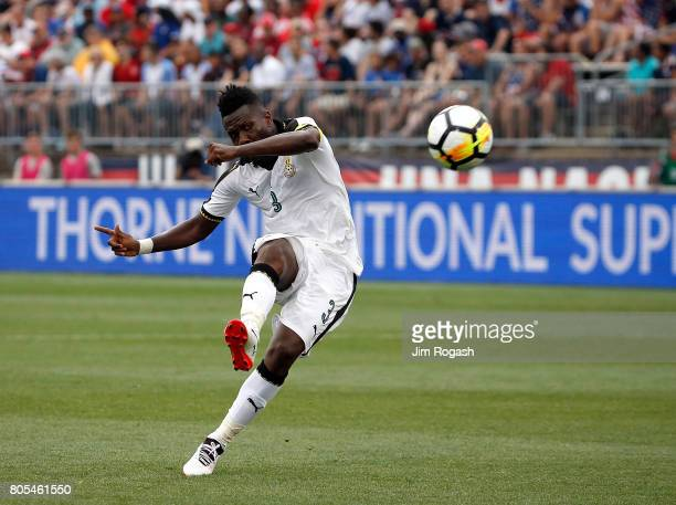 Asamoah Gyan of Ghana scores a goal against the United States defends in the second half during an international friendly between USA and Ghana at...