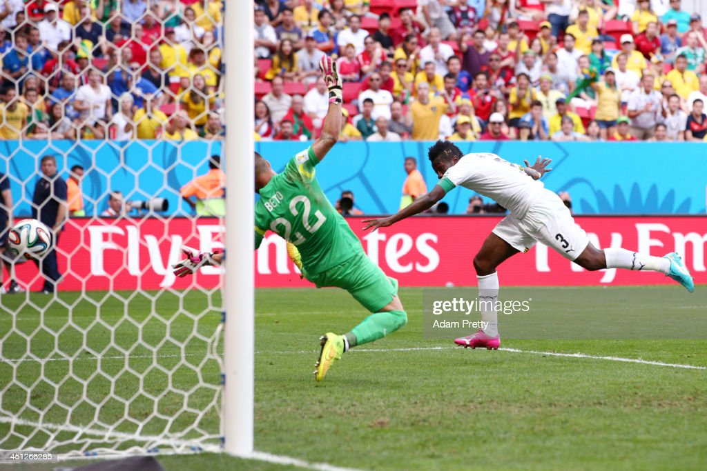 <a gi-track='captionPersonalityLinkClicked' href=/galleries/search?phrase=Asamoah+Gyan&family=editorial&specificpeople=535782 ng-click='$event.stopPropagation()'>Asamoah Gyan</a> of Ghana scores his team's first goal past goalkeeper <a gi-track='captionPersonalityLinkClicked' href=/galleries/search?phrase=Beto+-+Portuguese+Soccer+Goalie&family=editorial&specificpeople=5747462 ng-click='$event.stopPropagation()'>Beto</a> of Portugal during the 2014 FIFA World Cup Brazil Group G match between Portugal and Ghana at Estadio Nacional on June 26, 2014 in Brasilia, Brazil.