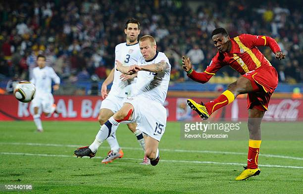 Asamoah Gyan of Ghana scores his team's second goal in extra time during the 2010 FIFA World Cup South Africa Round of Sixteen match between USA and...