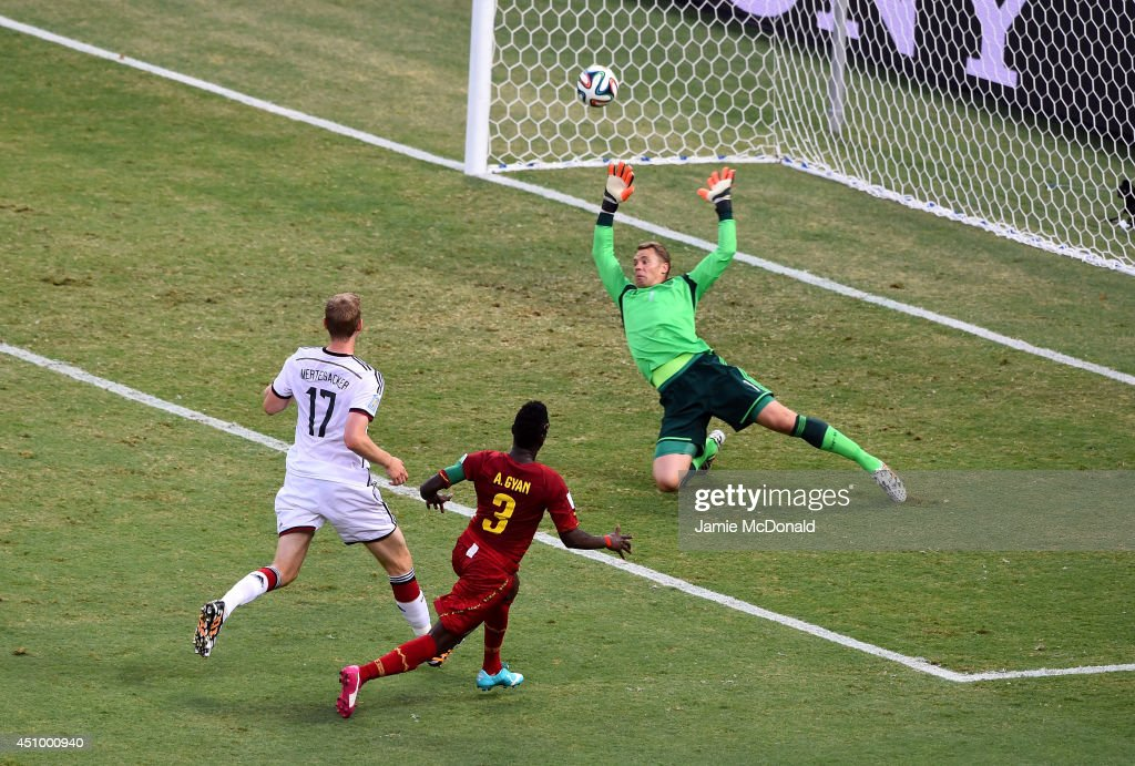 <a gi-track='captionPersonalityLinkClicked' href=/galleries/search?phrase=Asamoah+Gyan&family=editorial&specificpeople=535782 ng-click='$event.stopPropagation()'>Asamoah Gyan</a> of Ghana scores his team's second goal past <a gi-track='captionPersonalityLinkClicked' href=/galleries/search?phrase=Manuel+Neuer&family=editorial&specificpeople=764621 ng-click='$event.stopPropagation()'>Manuel Neuer</a> of Germany during the 2014 FIFA World Cup Brazil Group G match between Germany and Ghana at Castelao on June 21, 2014 in Fortaleza, Brazil.