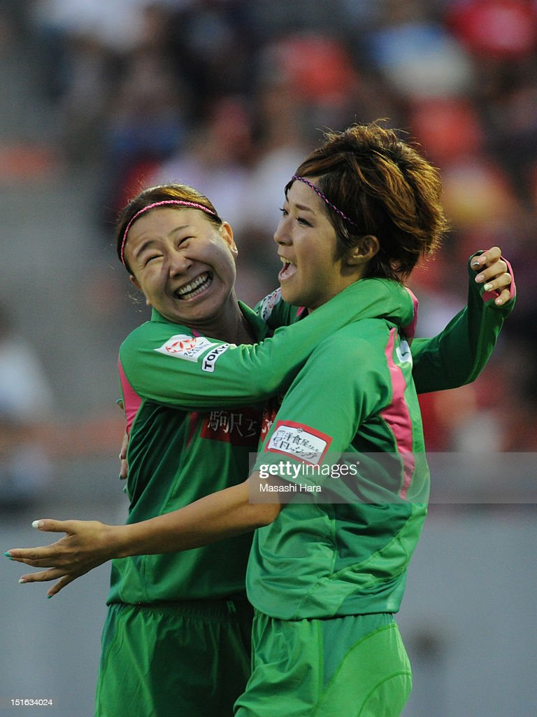 Asano Nagasato #9 (R) and Yayoi Kobayashi #8 of NTV Beleza celebrate the third goal during the Nadeshiko League Cup Final match between NTV Beleza and INAC Kobe Leonessa at NACK 5 Stadium Omiya on September 9, 2012 in Saitama, Japan.