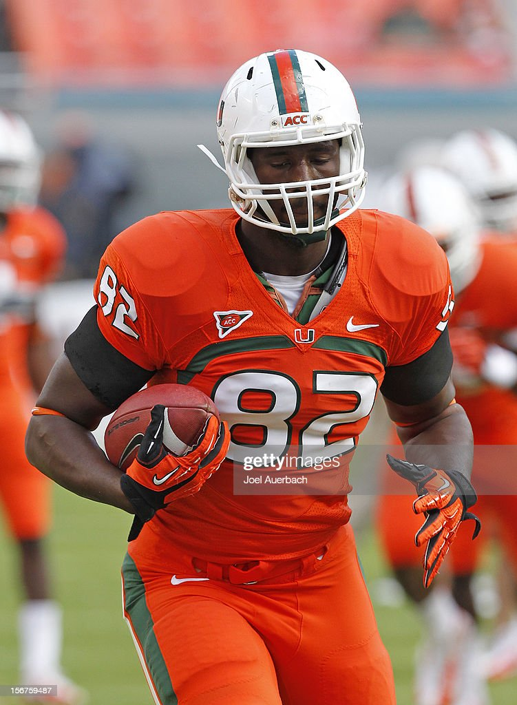 Asante Cleveland #82 of the Miami Hurricanes runs with the ball prior to the game against the South Florida Bulls on November 17, 2012 at Sun Life Stadium in Miami Gardens, Florida. The Hurricanes defeated the Bulls 40-9.